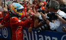 Fernando Alonso celebrates taking second place