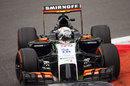 Sergio Perez navigates his way around the first chicane