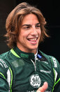 Roberto Merhi poses for the cameras in Caterham gear ahead of his debut F1 practice session
