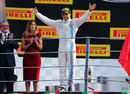 Felipe Massa waves to the fans on the podium