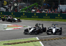 Kevin Magnussen and Valtteri Bottas go wheel-to-wheel at Turn 1