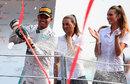 Lewis Hamilton sprays champagne on the podium