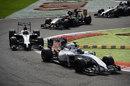 Valtteri Bottas leads Kevin Magnussen and Sergio Perez through the Rettifilo