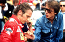 Luca di Montezemolo talks with Niki Lauda in the pits