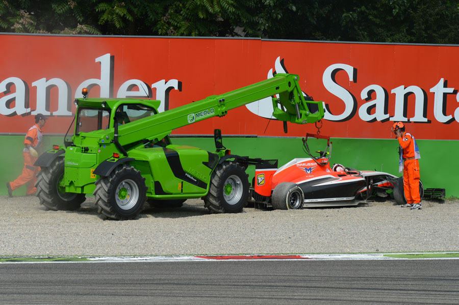 Max Chilton's stricken Marussia is recovered after he retired in the gravel at Roggia