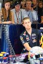 John Surtees watches on from Sebastian Vettel's pit garage