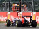 Sebastian Vettel passes a Red Bull pit board