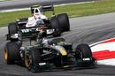 Jarno Trulli leads Kamui Kobayashi