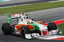 Paul di Resta uses all the kerb in the Force India