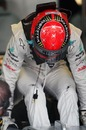 Michael Schumacher climbs from the cockpit of his Mercedes