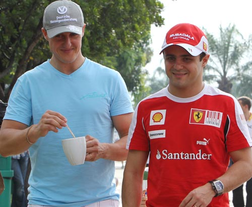 Michael Schumacher and Felipe Massa are all smiles after free practice