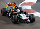 Sergio Perez rounds a corner with his front wing trapped underneath his Force India