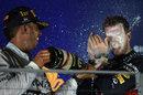 Lewis Hamilton soaks Sebastian Vettel on the podium