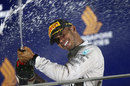 Lewis Hamilton sprays champagne on the podium