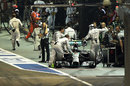 Nico Rosberg retires in the pit lane