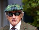 Sir Jackie Stewart arrives in the paddock