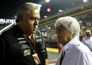 Vijay Mallya speaks to Bernie Ecclestone on the grid