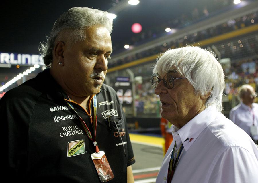 Vijay Mallya speaks to Bernie Ecclestone on the grid