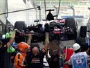 Jean-Eric Vergne's Toro Rosso is returned to the pits after stopping in FP2