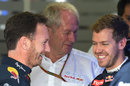 Christian Horner, Helmut Marko and Sebastian Vettel share a laugh in the garage after Red Bull's huge driver announcement on Saturday morning