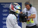 Lewis Hamilton in parc ferme after being beaten to pole by Nico Rosberg