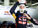 Daniil Kvyat puts on his helmet in the garage