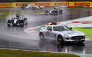 The two Mercedes drivers follow the safety car on lap one of the grand prix