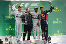 Lewis Hamilton, Nico Rosberg and Sebastian Vettel acknowledge the crowd during a sombre podium ceremony