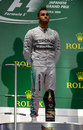 A subdued Lewis Hamilton watches on during the British national anthem