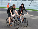 Force India's Sergio Perez and race engineer Gianpiero Lambiase cycle the Sochi circuit
