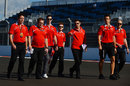 Alexander Rossi walks the track with the Marussia team