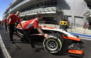 Max Chilton's Marussia heads for scrutineering