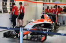 Jules Bianchi's unused car sits in the Marussia garage as a mark of respect