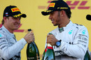 Nico Rosberg and Lewis Hamilton acknowledge each other on the podium
