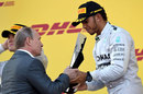 Russian president Vladimir Putin hands the trophy to race-winner Lewis Hamilton