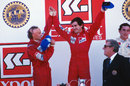1984 champion Niki Lauda celebrates with Alain Prost after beating him to the title by half a point