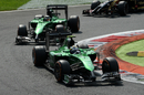 Marcus Ericsson leads Caterham team-mate Kamui Kobayashi through the first chicane
