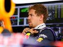 Sebastian Vettel looks on in the Red Bull garage during Friday practice