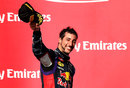 Daniel Ricciardo acknowledges the crowd on the podium after finishing third