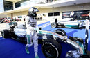Nico Rosberg walks from his car in parc ferme
