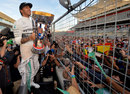 Lewis Hamilton celebrates victory with the fans on the main straight