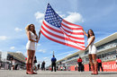 Grid girls hold up the American flag before the race