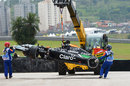 Dani Juncadella's Force India is lifted from the track after crashing in FP1