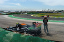 Dani Juncadella walks from his Force India after crashing out of the morning practice