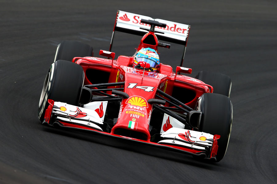 Fernando Alonso in the middle of a corner during qualifying