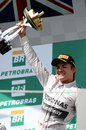 Nico Rosberg celebrates victory on the podium