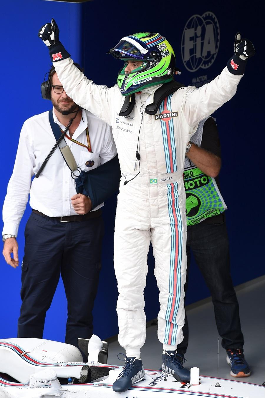 Brazilian Felipe Massa celebrates third place