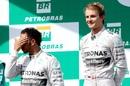 Nico Rosberg looks on after beating team-mate Lewis Hamilton
