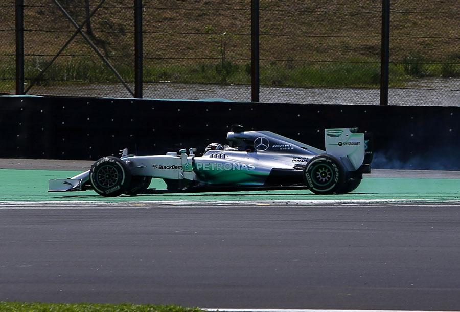 Lewis Hamilton spins off the circuit at Descida do Lago