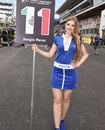 A grid girl stands next to Sergio Perez's number